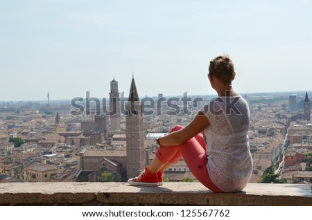 Girl looking to Verona town, Italy