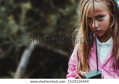 girl lost in the forest on a rainy day trying to communicate by gps with her gps phone #1524126464