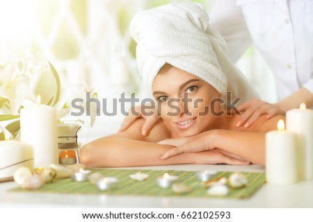 girl lying down on a massage bed