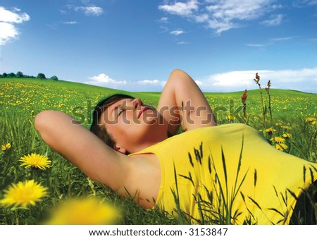 girl lying in a meadow enjoying the sun More pictures like this in my portfolio