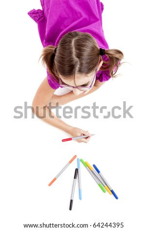 Girl lying on floor and making drawings on paper