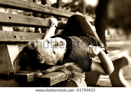 girl lying on the bench. retro portrait