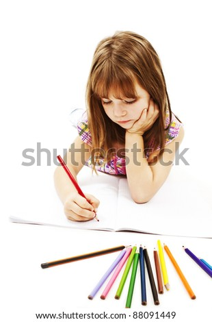 Girl lying on the floor and drawing on the paper. Isolated on white background