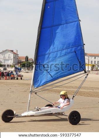 girl made of sailing chariot on the beach