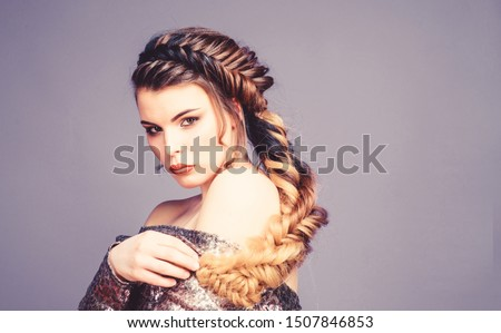 Girl makeup face braided long hair. French braid. Professional hair care and creating hairstyle. Braided hairstyle. Beautiful young woman with modern hairstyle. Beauty salon hairdresser art.