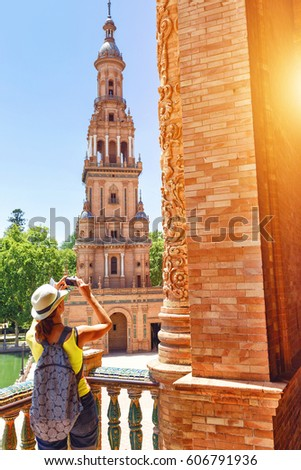 Girl making photo of famous historic touristic place at her travel. Backpack travel concept. Solo Female Traveler around the world. #606791936