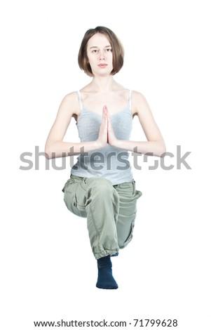 Girl making yoga exercises in gym isolated on white.