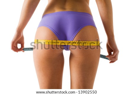 Girl measuring her side checking the result of diet, isolated on a white background