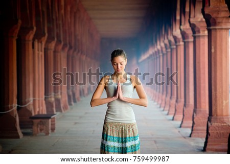girl meditates hands folded in namaste