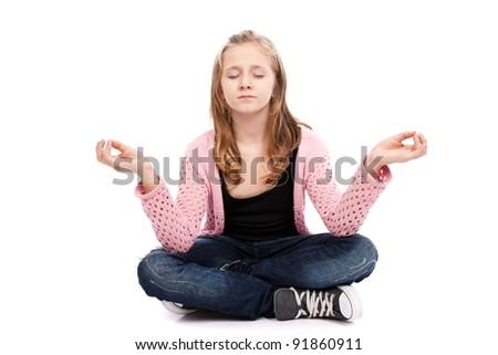 Girl meditating isolated on white background