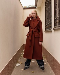 Girl model in a coat. Street style and fashion photo. Professional model.