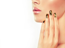 Girl model with   gold  metal manicure  nails. Cosmetics,makeup and beauty