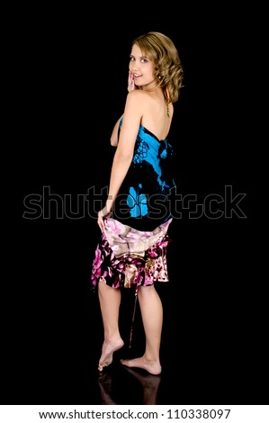 Girl-next-door beauty removing her dress to reveal a sarong.