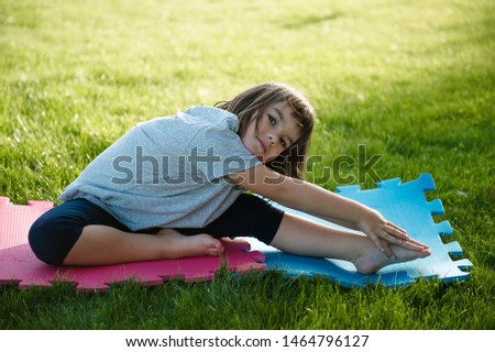 Young beautiful girl doing gymnastic jumps outdoors Images and Stock
