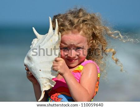 Girl of walking on the beach