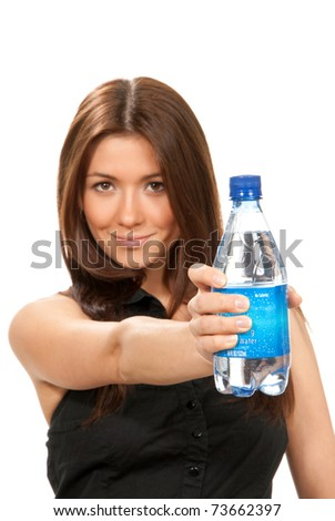 Girl offer and give bottle of pure still drinking water for diet. Female holding in hand sparkling mineral bottled water isolated on a white background