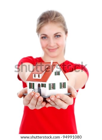 Girl offering a miniature house for us, concept