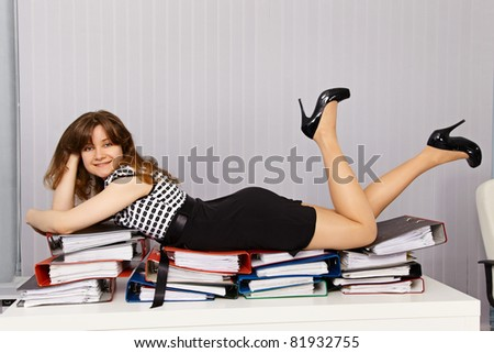 Girl - office worker lay down comfortably on the documents