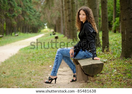 Girl on a bench in a park avenue
