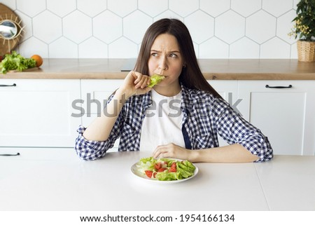 Girl on a diet eating fresh salad, changing food habits, healthy eating. High quality photo Photo stock ©