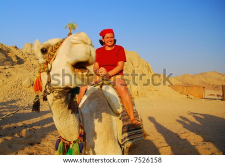 http://image.shutterstock.com/display_pic_with_logo/68798/68798,1196783329,1/stock-photo-girl-on-a-funny-camel-eastern-sahara-in-egypt-7526158.jpg