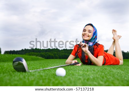 girl on a golf a field