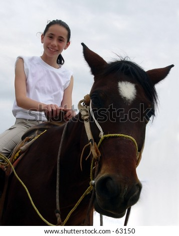 Girl on a horse - stock photo