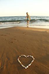 girl on beach with heart