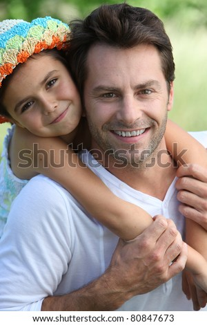 Girl on father's back