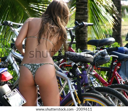 Ljepotice i bicikli - Page 2 Stock-photo-girl-on-ipanema-beach-picking-up-her-bicycle-2009611