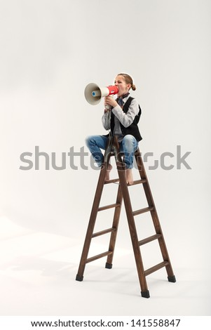 Girl on ladder speaking with megaphone