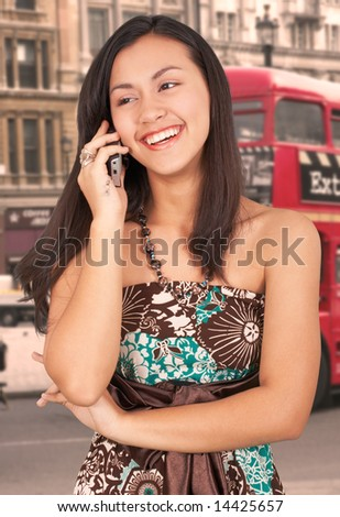 girl on phone in a city street
