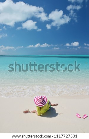 Girl on the beach. Great Exuma, Bahamas  #1117727531