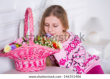 girl on the bed with a basket of flowers