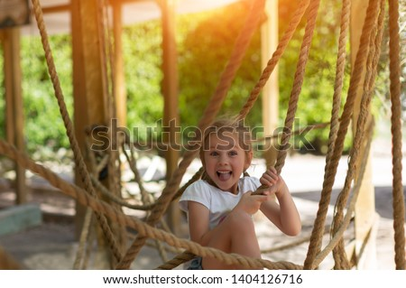 girl on the obstacle course, high ropes course, summer, joy, health, good morning ストックフォト ©