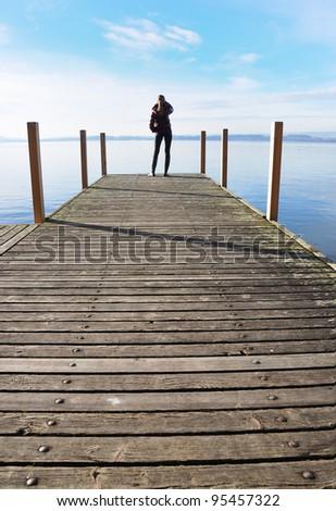 Girl on the pier. Lake of Zug, Switzerland - stock photo