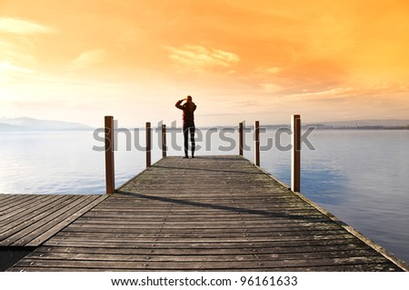 Girl on the pier. Lake of Zug, Switzerland
