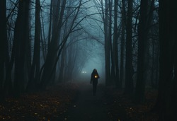 Girl on the road in a mysterious forest. Background wallpaper. Strange forest. Mystic atmosphere. Dark scary road. Paranormal another world. Ghost in the fog. The pursuit. Horrible dream.
