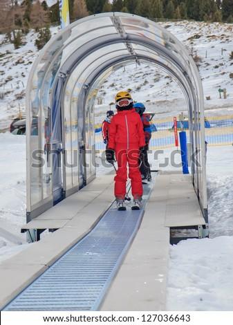 Girl on the ski carpet