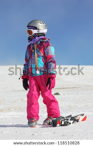 Girl on the snow - stock photo