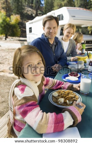Girl on Vacation with Her Family