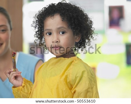 Girl painting in art class, portrait