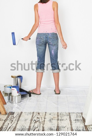 Girl painting living room