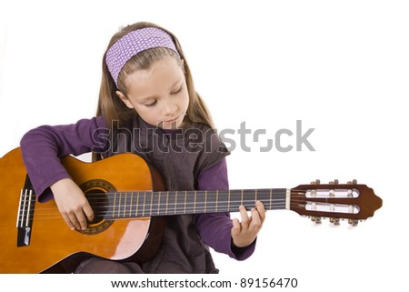 girl play a guitar/music/beginner