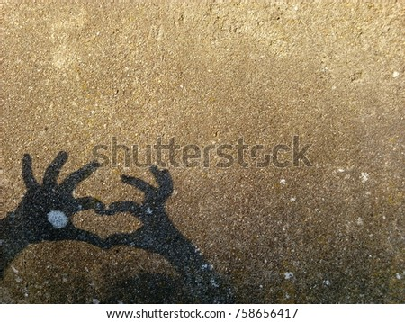 girl play hands with shadow on cement wall #758656417