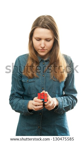 Girl playing a cube game.