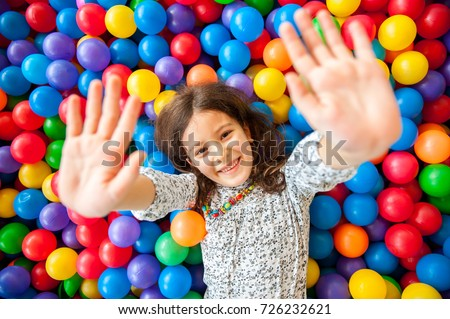 Girl playing and having a good time in a ball room