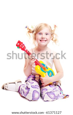 girl playing his toy guitar