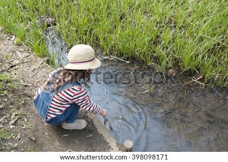 Girl playing in the creek