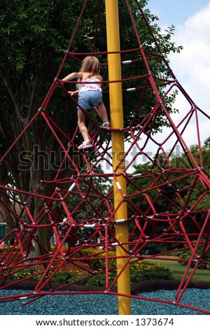 girl playing on ropes